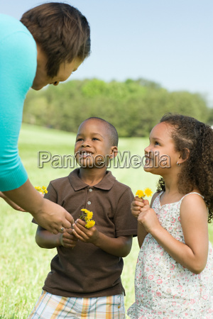 mother and children with flowers