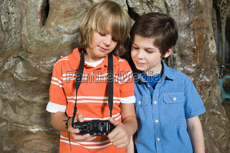two boys looking at a camera