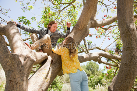 young couple in a tree
