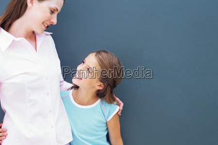 girl looking up at mother