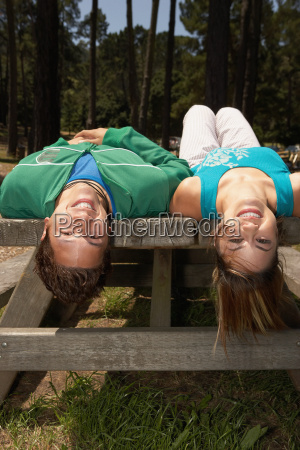 young couple lying on a picnic