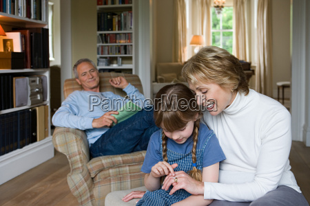 girl looking at grandmothers wedding ring