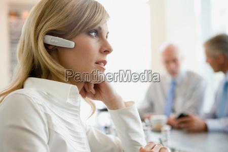 woman wearing headset at bar counter