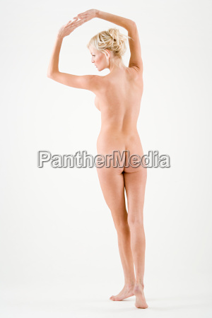 nude woman stretching