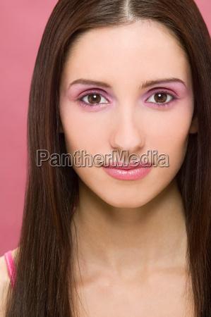 woman wearing pink make up