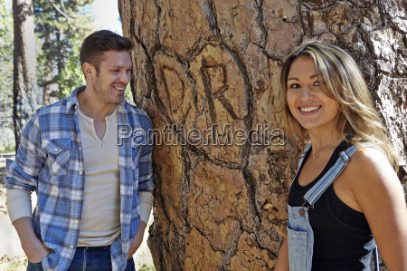 portrait of young couple in forest