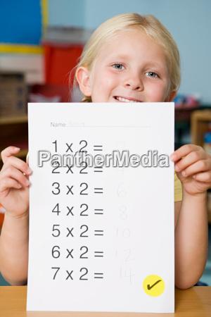 girl holding exam paper
