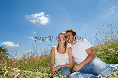 couple sitting in a field