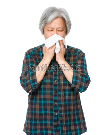asian old woman sneeze