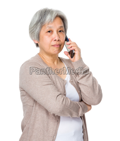 asian old woman talk to cellphone
