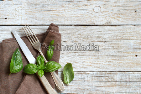 vintage fork and knife with basil