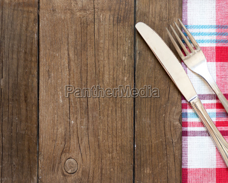 fork and knife on kitchen towel