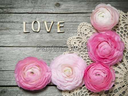 ranunculus flowers and letters love on