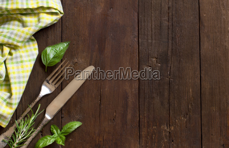 vintage fork and knife with herbs