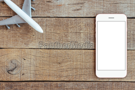 phone and airplane toy on wood