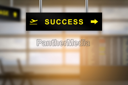 success on airport sign board