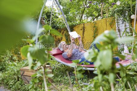 woman relaxing on a swing in