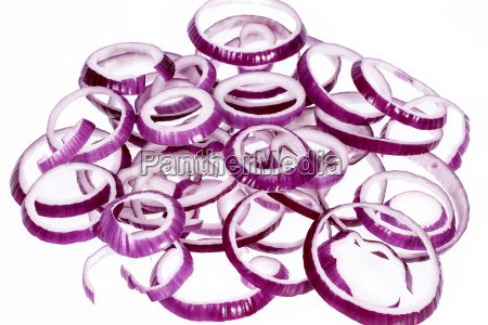 red onion slices on white background