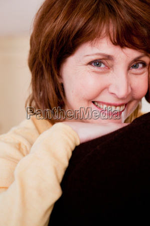 woman smiling looking at viewer