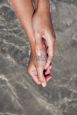 close up of womans hands at
