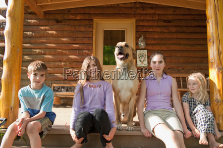 portrait of kids and dog at