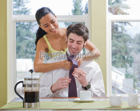 woman helping man get dressed