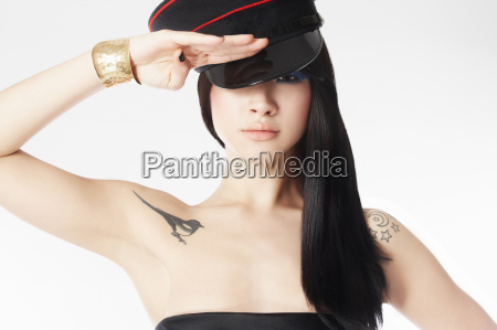 young woman wearing military hat and