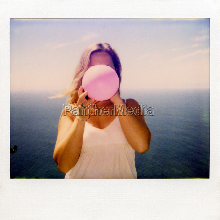 instant film photograph of woman blowing