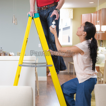 woman helping man with home improvements
