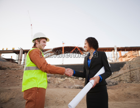man and woman on work site
