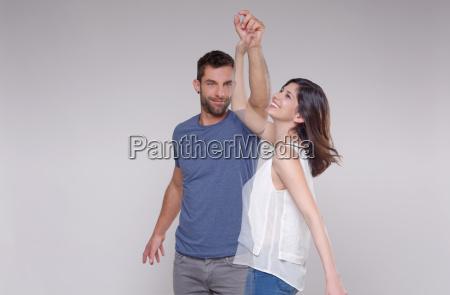 man dancing with transparent woman