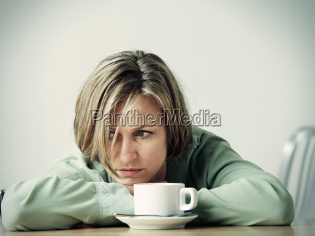 woman resting head in hands at