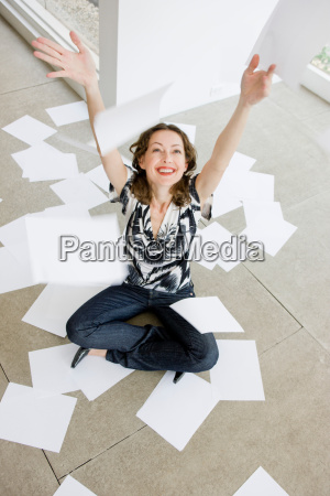 woman throwing paper sheets into the