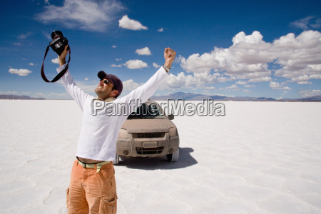 photographer celebrates in a salt field