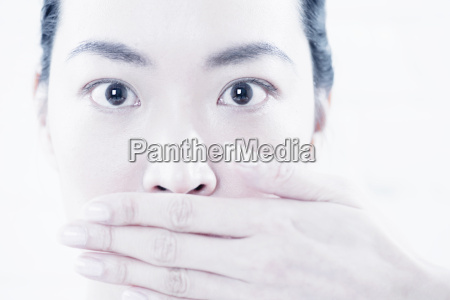 close up of woman covering her