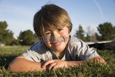 portrait of smiling boy lying on