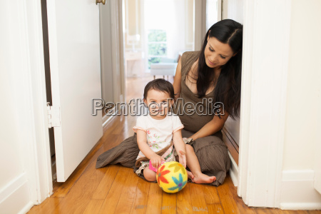 mother and child at development play