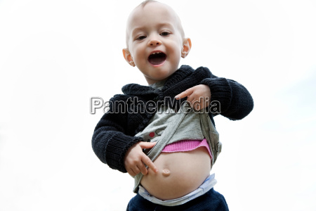 little girl pointing to her belly