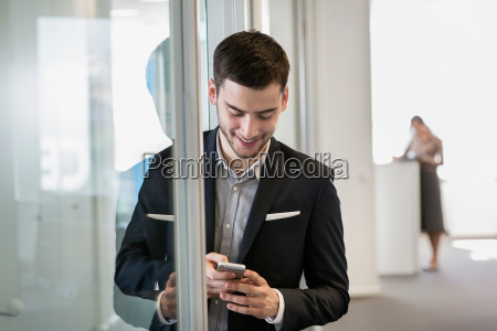 businessman using cell phone woman in