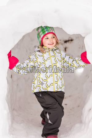girl wearing winter clothes standing in
