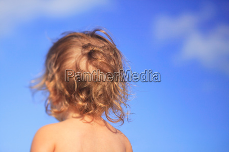 close up of back of toddlers