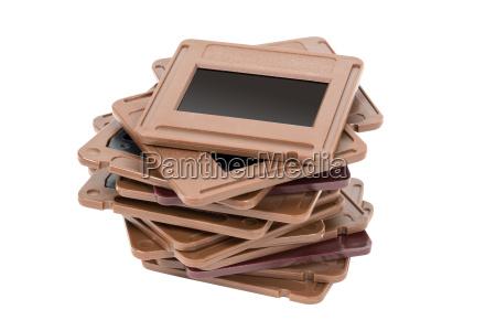 stack of photo slides on white