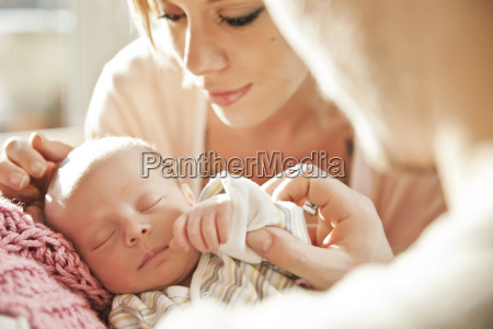 parents looking at their newborn baby
