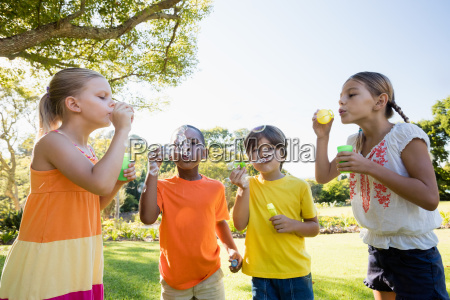 children playing with bubble wand