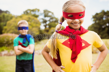 children wearing superhero costume posing for