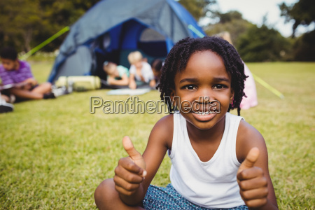 happy child doing thumbs up during