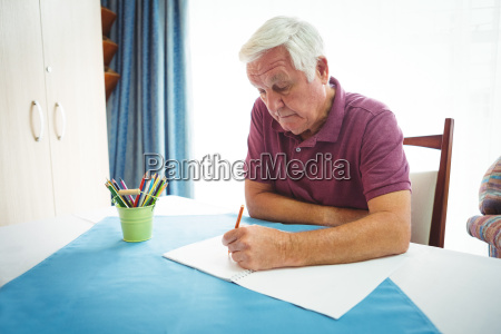portrait of retired man writing on
