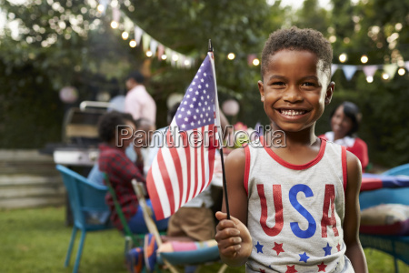 young black boy holding flag at