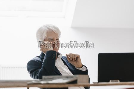 smiling senior businessman on the phone