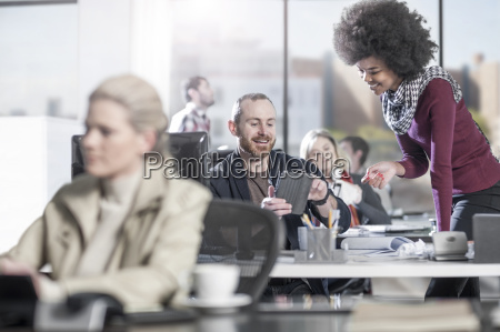 smiling man at desk in office